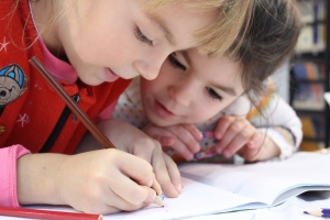 Two girls coloring together