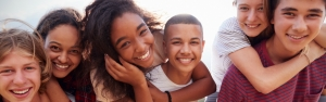 Teens piggybacking and smiling